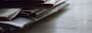 stack of newspapers on desk